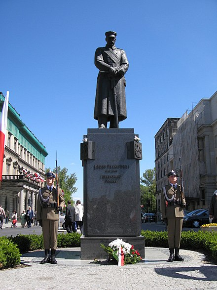 Statue of Pilsudski on Warsaw's Pilsudski Square--one of many statuary tributes throughout Poland Pilsudski statue and honour guards.jpg