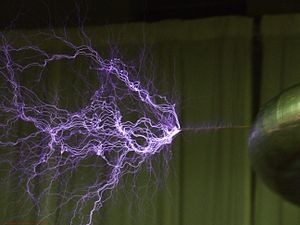 High voltage - High voltages may lead to electrical breakdown, resulting in an electrical discharge as illustrated by the plasma filaments streaming from a Tesla coil.