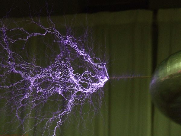 High voltages may lead to electrical breakdown, resulting in an electrical discharge as illustrated by the plasma filaments streaming from a Tesla coil. Plasma-filaments.jpg