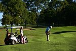 Players on course with buggy (7037379563).jpg