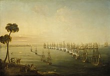 A broad view of a bay. Running vertically from the foreground to the background is a line of 14 anchored ships flying red, white and blue tricolour flags. to their left are four more anchored ships and to the left of these vessels is a distant shoreline. In the foreground of this shore is a hillside on which several men in turbans watch the scene below. To the right of the line a number of ships with all sails set are grouped around the head of the line, as smoke rises from many of the ships on both sides.