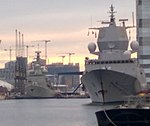 Portuguese and Norwegian warships moored at South Quay in London.jpg