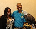 Posing for picture with Bald Eagle. (10595245144).jpg