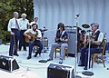 President Jimmy Carter with the Blue Grass Band, Bill Monroe and Company, at the Bandshell on the South Lawn.jpg