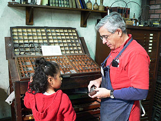 International Printing Museum - Peter Small showing a student how Ben Franklin set type by hand.