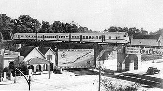 Belgrano Norte Line - Ganz Works railcar crossing Avenida del Libertador in Vicente López Partido.