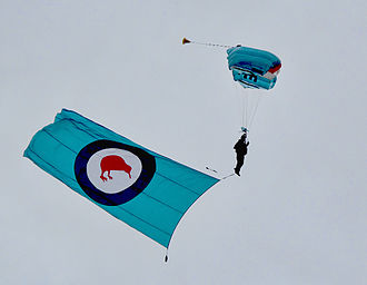 RNZAF Base Auckland - A member of the RNZAF Parachute Training and Support Unit trails the air force flag during the air show at Whenuapai in March 2009.