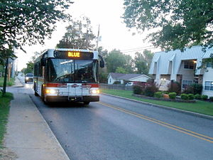 Razorback Transit - A Blue bus stopps at North Creekside Apartments