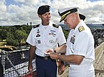 Re-enlistee receives command coin 140704-N-WF272-060.jpg
