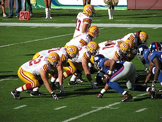 Away colours - Washington Redskins in white throwback jerseys at home versus the New York Giants.