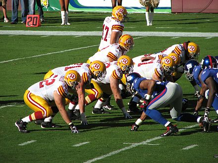 The Washington Redskins gather at the line of scrimmage against the Giants. Redskins vs Giants line of scrimmage throwbacks.jpg