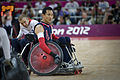 Retired U.S. Sailor William Groulx, the U.S. wheelchair rugby team captain, rolls into position to defend against the Great Britain team during a match at the Paralympic Games in London Sept 120905-F-FD742-702.jpg