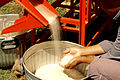 Rice coming out of rice micro mill - IRRI Images.jpg