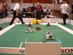 Competitions and prizes in artificial intelligence - A legged league game from RoboCup 2004 in Lisbon, Portugal.