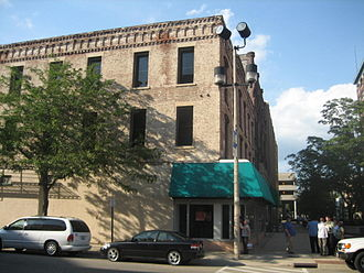Chick House - The green awning was added after the city of Rockford purchased part of the building in 2004.
