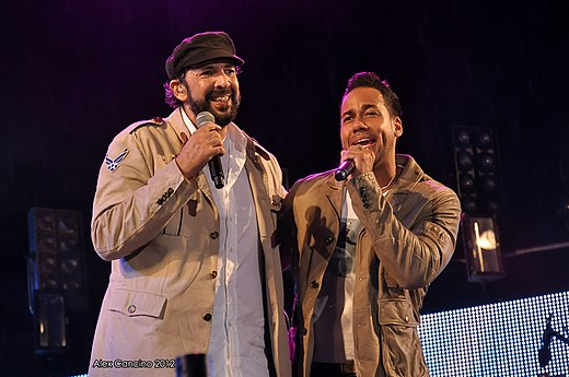Merengue and Bachata are both music genres native to Dominican Republic, popular and traditional in Latin America. In the image two icons of these genres Juan Luis Guerra and Romeo Santos Romeo Santos y Juan Luis Guerra.jpg