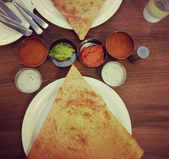Dosa - Dosa with sambar and various chutneys as served in a restaurant