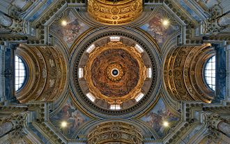 Sant'Agnese in Agone - View into frescoed cupola and pendentives; apse on left, entrance with organ and tomb of Pope Innocent X on right