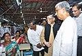 Santosh Kumar Gangwar along with the Chief Minister of Tripura, Shri Manik Sarkar taking a round of the Apparel and Garment making centre, at Bhudjangnagar, in Agartala (1).jpg