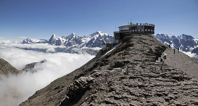 http://upload.wikimedia.org/wikipedia/commons/thumb/0/03/Schilthorn_with_Bernese_Alps%2C_2012_August.jpg/640px-Schilthorn_with_Bernese_Alps%2C_2012_August.jpg