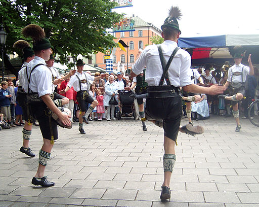 men dancing in lederhosen