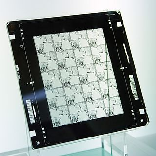 Photomask opaque plate or film with holes or transparencies that allow light to shine through in a defined pattern
