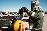 Sgt. Dave Jones, a member of the 58th Tactical Fighter Wing weapons section, checks the fins on an AIM-9 Sidewinder missile during a simulated chemical warfare exercise in support of Exercise Nomad Thrust '88 DF-ST-88-08702.jpg