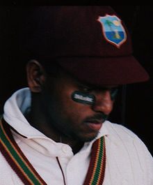 Shivnarine Chanderpaul, wearing his West Indies cricket kit, with anti-glare patches beneath his eyes.