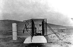 Side view of the original Wright Aeroplane nea...