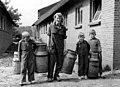 Sjouwen van melkbussen (Doornspijk) - Children helping out at a dairy farm (5896773071).jpg