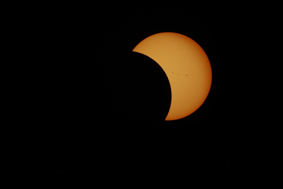 Solar Eclipse through a Compound Telescope.jpg