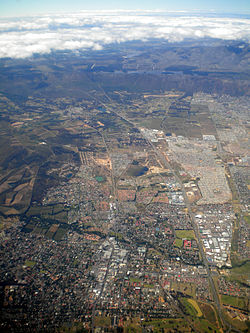 Aerial view of Somerset West with Hottentots-Holland Mountains and the Steenbras Dam in the background