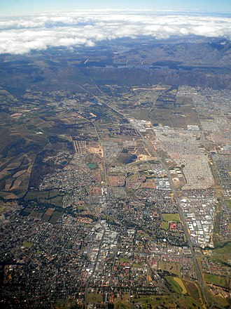 Somerset West - Aerial view of Somerset West with Hottentots-Holland Mountains and the Steenbras Dam in the background