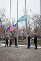 Soyuz MS-08 crew and backup crew raise flags.jpg