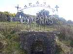 "St Dympna's shrine and well, Caldavnet, Tydavnet, Co Monaghan (No legal right of way onto this site.) Saint Davnet (in Gaelic Damhnat) lived and died at Sliabh Beagh in the parish of Tydavnet (Tigh Damhnait = ""house of Davnet""), Co. Monaghan. Tradition speaks of her as a virgin who in the sixth century founded a church or monastery in the area (generally considered to have been located in the graveyard of the current village Catholic church). A 10th century ornamental pilgrim's staff, the bachall Damhnait (""staff of Davnet""), said to have been hers is on display in the National Museum. In the past it was kept for generations in the parish and was often used as a test of truth. At Caldavnet at the northern end of the parish is St. Dympna's Well, still a major place of pilgrimage. The local school is called St Dympna's and the major psychiatric hospital (built 1869-71) in nearby Monaghan town is called St Davnet's. Also there is a link between the village of Tydavnet and the town of Gheel 25 miles east of Antwerp in Belgium. The body of St Dympna, the patron saint of the mentally ill, is displayed in a silver reliquary in a church in Gheel named in her honour. She has her own feast on May 15th. http://www.catholicireland.net/pages/index.php?nd=367=1234"