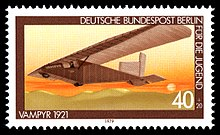 A postal stamp showing a small glider