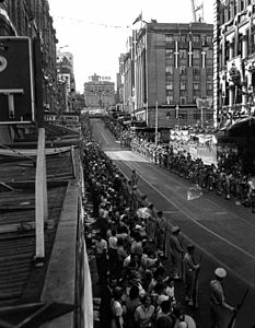 StateLibQld 1 106272 Crowds line Edward Street waiting for a glimpse of Queen Elizabeth and Prince Philip, Brisbane, March 1954.jpg