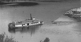 Adams Lake - Sternwheeler Helen towing a log boom on Adams Lake, c.1920