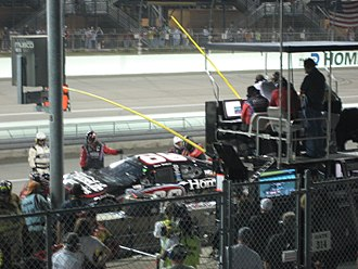 2007 NASCAR Busch Series - No. 66-Steve Wallace's team works on his car after making contact with another car during the Ford 300.