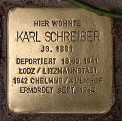 Photo of Karl Schreiber brass plaque