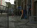 Street scene of Amsterdam-West with buidling fences near Kinkerstraat in Amsterdam Oud-West - Dagelijkse straat-scene, met bouwhekken in Amsterdam Oud-West van de Tollensstraat die de Kinkerstraat kruist..jpg
