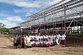 Students from Caritas Technical Secondary School outside the structure of the new library funded by AusAID, East Boroko, PNG. (10726015674).jpg