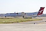 Sunstate Airlines (VH-QON) Bombardier DHC-8-402Q taxiing to taxiway Echo at Sydney Airport.jpg
