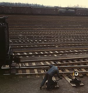 Switchman - A 1943 color photograph of a switchman at work at the Chicago and North Western Railway's Proviso Yard in Chicago.