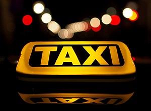 Taxicab - A luminous taxi top sign