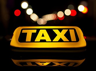 Taxicab - A luminous taxi top sign