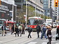 TTC streetcar visible by Dundas Square, 2015 12 01 (12) (23453663506).jpg