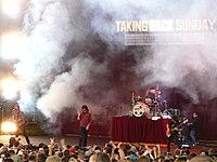 Taking Back Sunday on a smoky stage