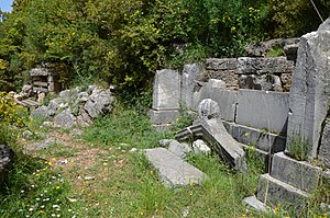 Temple-shaped facade tomb carved into the natural rock, built during the 3rd century BC, Necropolis of Phigaleia, Arkadia, Phigaleia (13949376500).jpg