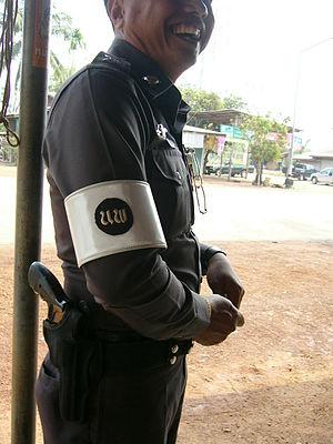 English: Royal Thai Police officer responsible...
